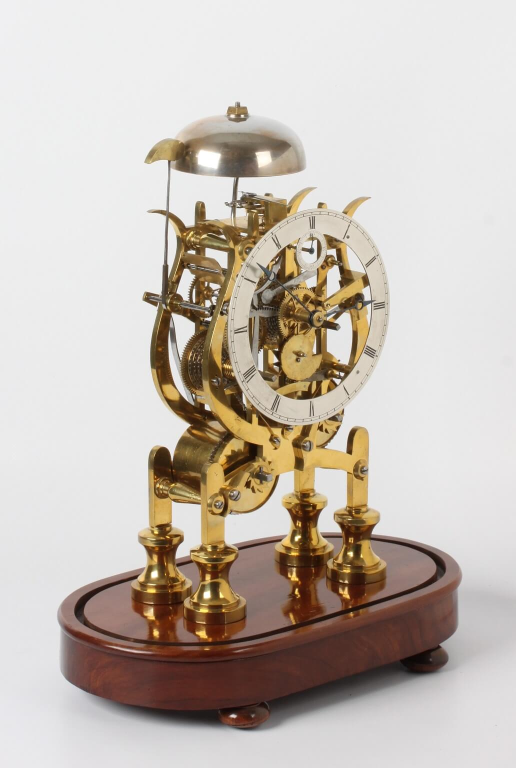 English brass skeleton clock striking balance Dent 1840