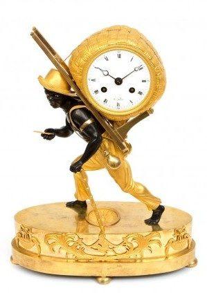 A French Empire 'portefaix' Bon Sauvage Mantel Clock, Circa 1800