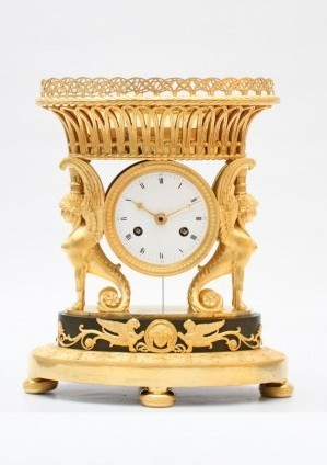 A French Empire Ormolu Urn Mantel Clock With Griffins, Circa 1800