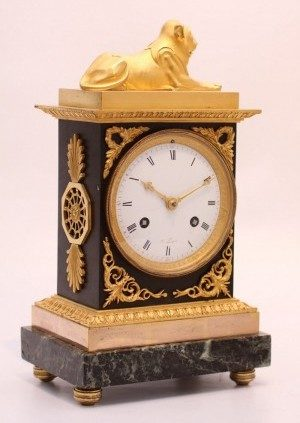 A French Empire Gilt And Bronze Mantel Clock, Circa 1800