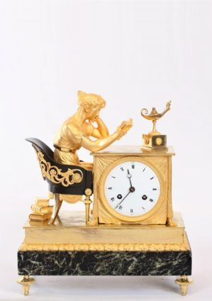 A French Empire Patinated And Gilt Bronze Mantel Clock, La Lectura, Circa 1800