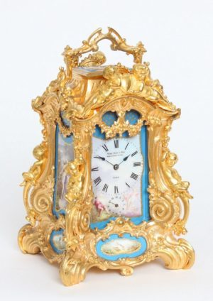 A Rare French Gilt Bronze Rococo Case Travel Clock With Sèvres Panels By Drocourt, Circa 1870