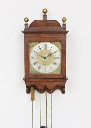 A Rare Dutch Walnut Hooded Wall Clock By Jacob Hasius, Circa 1725.
