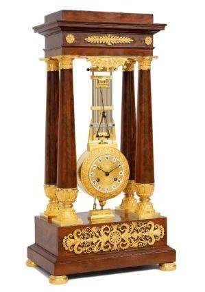 A French Late Empire Mahogany Oscillating Portico Mantel Clock, Circa 1825