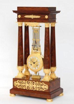 A French Late Empire Mahogany Oscillating Portico Mantel Clock, Circa 1825